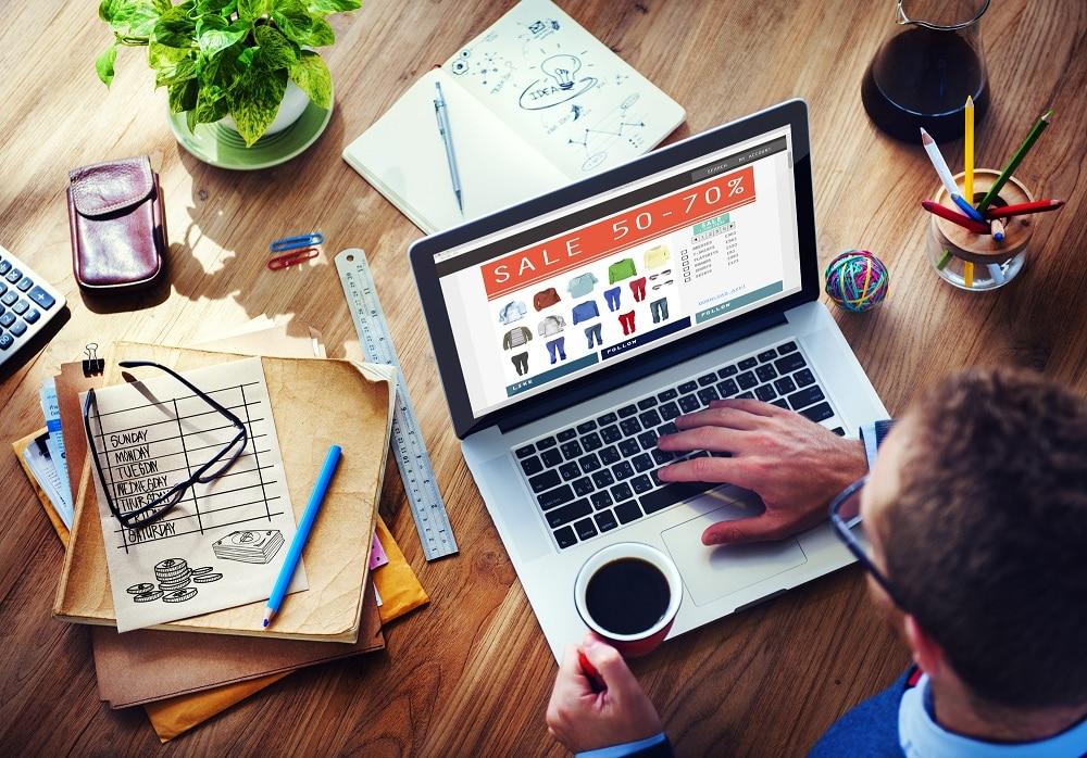 Man doing Online Marketing Ecommerce Sale - Infintech Designs